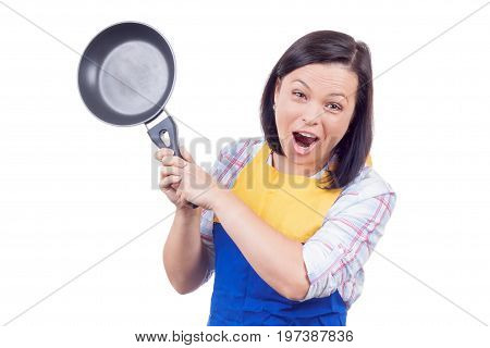 Anger Fury and Rage Young Woman with Frying Pan on a white background