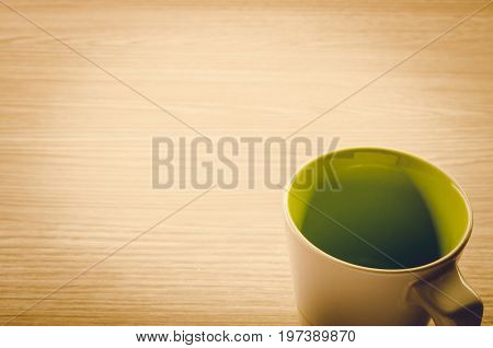 Coffee Cup On Wooden Background: Vintage Tone