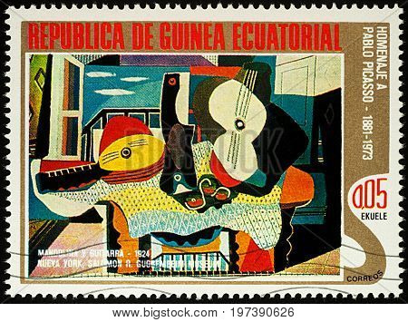 Moscow Russia - July 27 2017: A stamp printed in Equatorial Guinea shows painting Mandolin and guitar by Pablo Picasso series