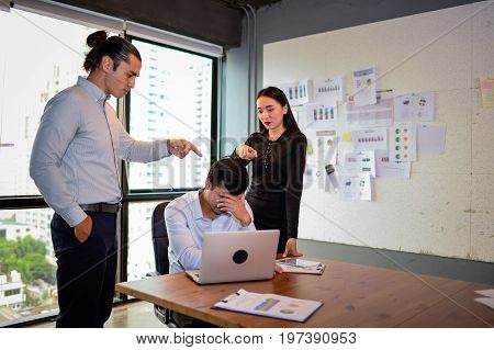 businessman is nervous and put his hand on head because his boss and colleague very angry and Pointing fingers at him. The concept of business mistakes.