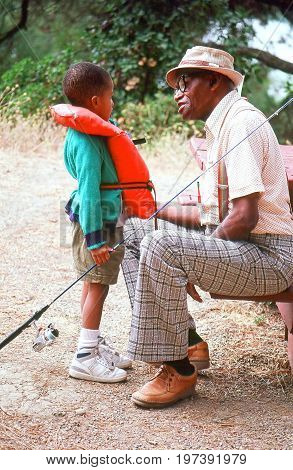 SEATTLE, WA. OCT 17, 2005. CIRCA: Grandpa and grandson going fishing together for the first time in Seattle, Wa.