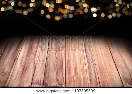 image of wooden table with bokeh christmas lights background and copy space ideal for display or montage your products and text