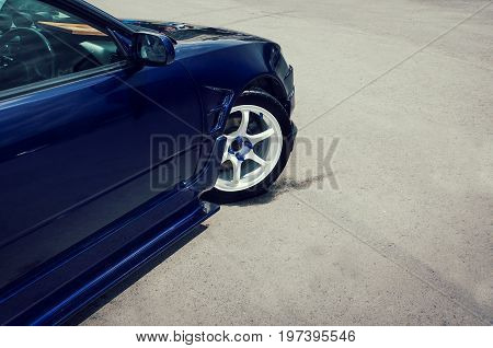 Side View Of Turning Luxury Car