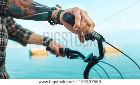 Closeup Of A Cyclist Hand On Bike Handlebars Holiday Activity Transportation Concept