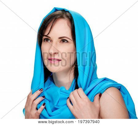 Pretty young smiling woman wearing blue shawl
