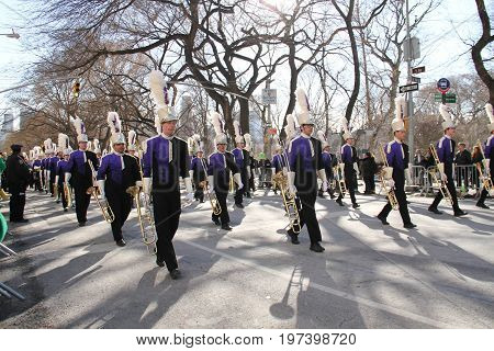 Manhattan, New York March 17, 2017: Marching band in parade on st patrick's day and trees at Central Park
