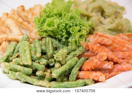 A Deep fried vegetable covered in breadcrumbs