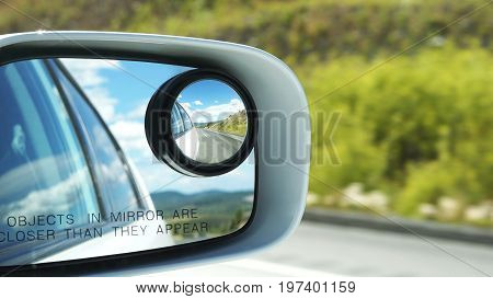Side rear view mirror on a car