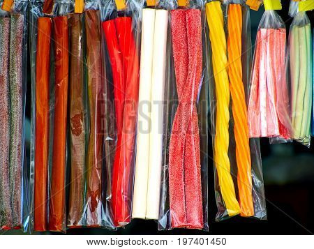 Soft sticks bundle colored licorice candies on display in a market shop