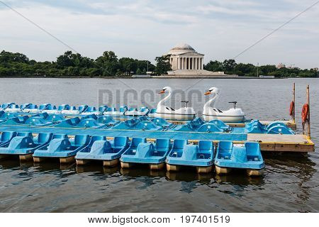 WASHINGTON, DC - JULY 12, 2017:  Swan boats and Paddleboats lined up near the Jefferson Memorial in the Tidal Basin.
