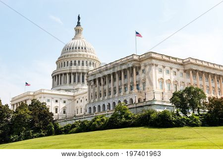 WASHINGTON, DC - JULY 12, 2017:  The U.S. Capitol Building, one of the most recognizable buildings in the world, and the home of Congress.