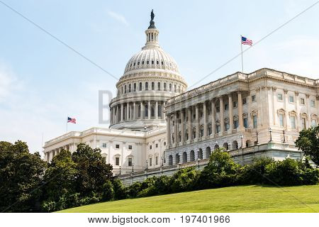 WASHINGTON, DC - JULY 12, 2017:  Side view of the U.S. Capitol Building, home of Congress, and located atop Capitol Hill at the eastern end of the National Mall.