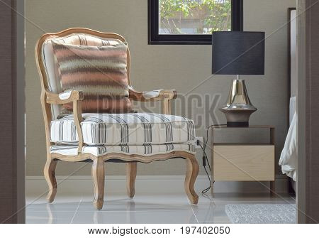 Comfortable Classic Style Lounge Chair Next To The Bedside Table