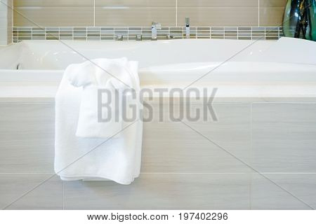 Closeup Bathtub With White Towels In Modern Style Bathroom