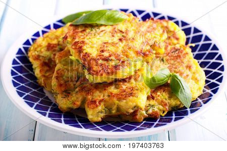 Courgette and dill fritters on plate served
