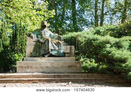 Statue Of Anonymus Located In City Park In The Courtyard Of Vajdahunyad Castle, Budapest
