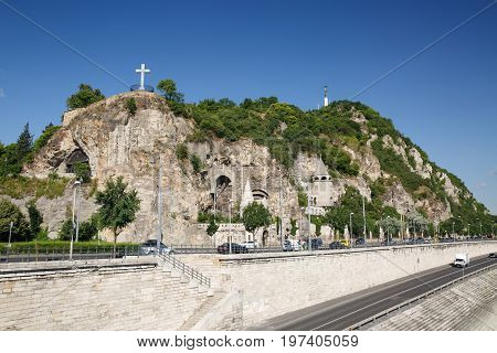 Cave Church, Cross And Statue Of Liberty On The Gellert Hill In Budapest