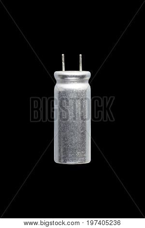 Aluminum electrolytic capacitor Isolated on black background Electronics part concept.