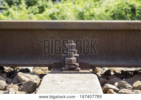 Railway rail with fastening on concrete sleepers