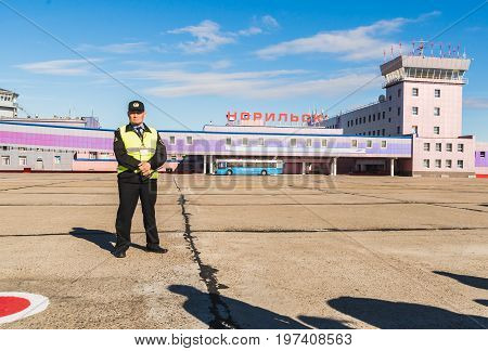 Norilsk, Russia - June 27, 2017: Security officer at the Norilsk airfield