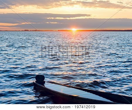 Sunset And Drowned Boat On Summer Lake Bank