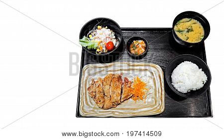 Japanese Cuisine Set Fried Chicken Rice Salad and Miso Soup on White Background Clipping Path
