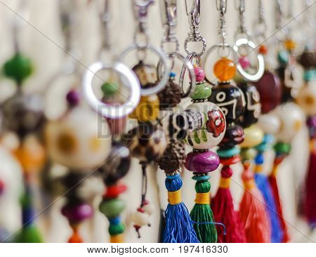 keyring are hanging on the display of shop
