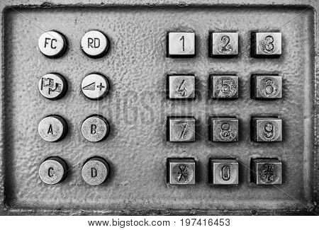 Close Up Old Button Number Payphone.