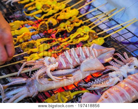 Barbeque Grilled Fresh Squid On Charcoal Stove.