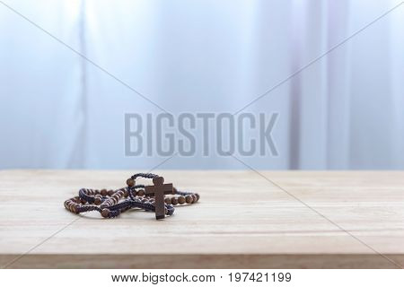 Close up of Catholic rosary beads on wooden table