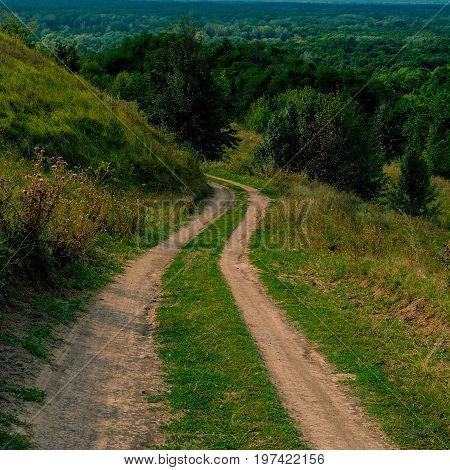 Dirt road in a hilly landscape rural landscape