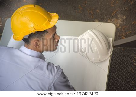 Architect working on blueprint.engineer inspector in workplace - architectural project, High angle view,Top view,blueprint ,Construction concept.