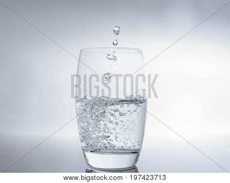 Filling water in glass - drink water in water glass