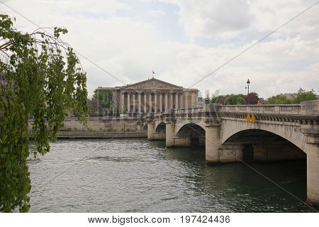 ParisFrance- April 29 2017: View of the National Assembly. Across the bridge is the pedestrians