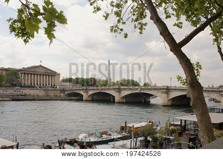 ParisFrance- April 29 2017: View of the National Assembly. On the waterfront are cars and pedestrians