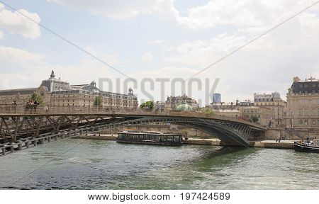 ParisFrance- April 29 2017: View of the bridge Leopold Sedar Senghor. Pedestrians walk and rest