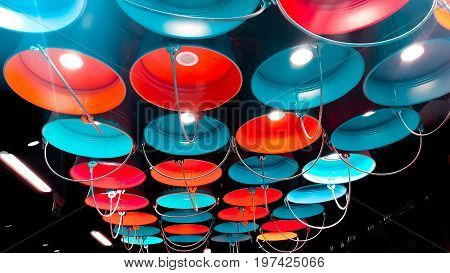 Paint buckets with various color. Decorative lamps in the form of a bucket with a paint.