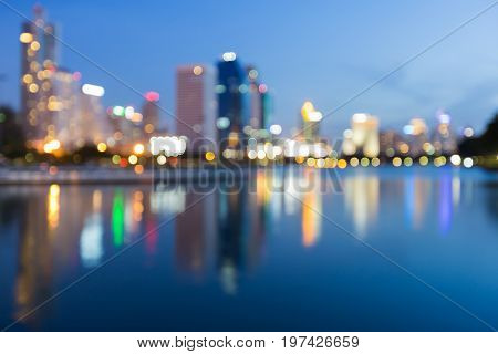Blue twilight city reflection light city office building downtown abstract background