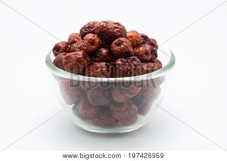 Dried red jujube fruit on white background