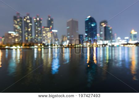 Office building blurred bokeh light night view with reflection abstract background
