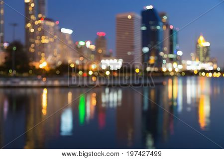 Reflection city light blurred bokeh water front abstract background