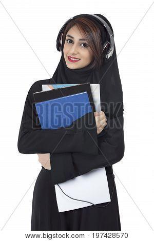 Arab student wearing abaya holding documents and notes