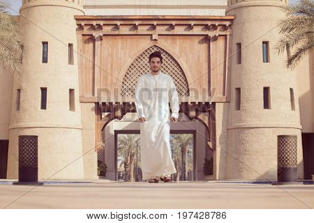 Arab model wearing kandoura posing outdoor old dubai