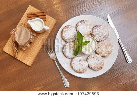 Cottage cheese curd pancakes or fritters with mint. Traditional Russian and Ukrainian cuisine