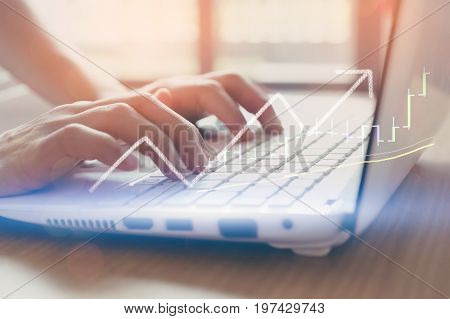 Business Economic And Technology Working Concept. Woman Hand Using Keyboard Notebook Double Exposure