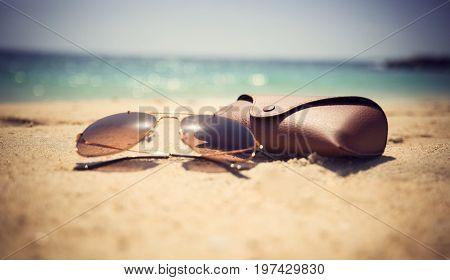 Summer time sunglasses on the sand of jumeira beach Dubai UAE