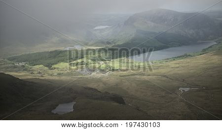 Landscape View Of Llyn Cwellyn And Moel Cynghorion In Snowdonia Shrouded In Fog And Cloud