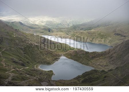 Landscape Image Of Glaslyn And Llyn Llydaw In Snowdonia With Glyder Fawr In The Background With Fog