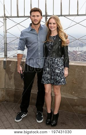 NEW YORK-APR 9: Actor Scott Eastwood (L) and Britt Robertson visit The Empire State Building on April 9, 2015 in New York City