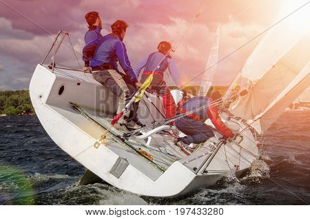 Sailing yacht race, regatta. Recreational Water Sports, Extreme Sport Action. Healthy Active Lifestyle. Summer Fun Adventure. Hobby. Team athletes participating in the sailing competition